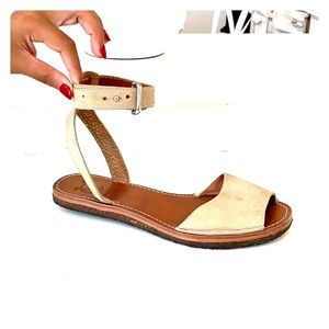 Tan leather ankle strap sandals.